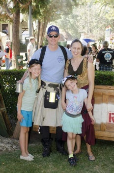 Justin S. and his fam at the Highland Games last year. And yes, that is a kilt.