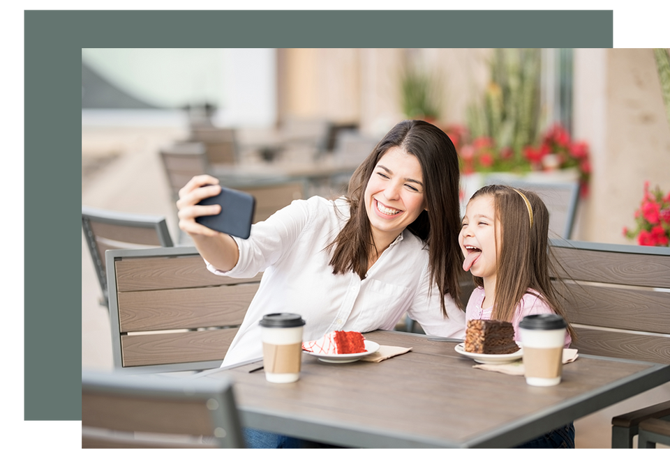Mother and daughter taking a selfie with their smartphone