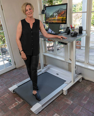 Diann Wingert standing on her Unsit Treadmill Desk shot from back right