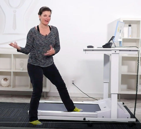 Jacki Burge of Desk Yogi demonstrating the Unsit Treadmill