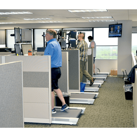 Several Unsit Treadmill Desks being used in cubicles in a Multi-Bank Securities Office