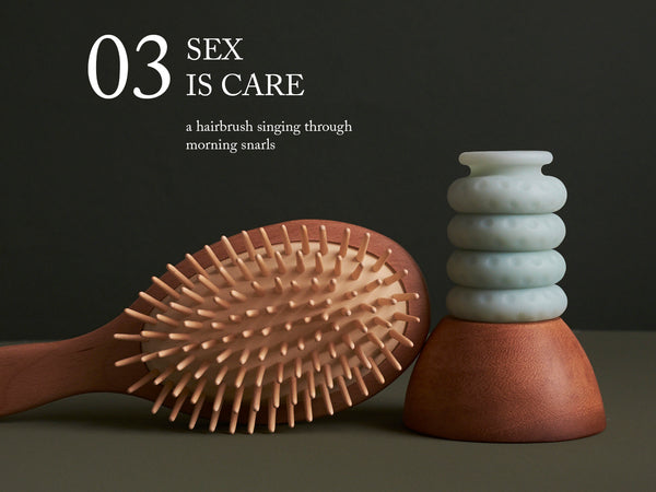 "Image of a wooden hairbrush sitting next to an Ohnut. ""03. Sex is care—a hairbrush singing through morning snarls."""