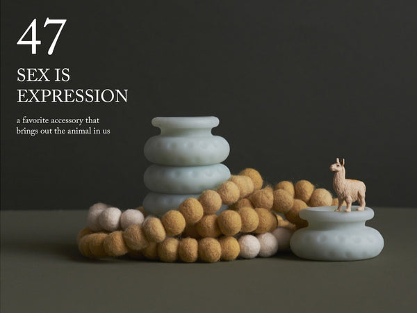 "Image of a felt necklace wrapped around an Ohnut. A llama also perches majestically on a separate Ohnut ring. ""47. Sex is expression—a favorite accessory that brings out the animal in us."""