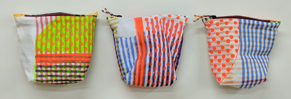 small zippered bag made from screen printed linen