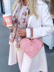 Into the Woods founder Catherine Woods with Rosé Pink Love Heart Handwoven, Handmade Palm Handbag