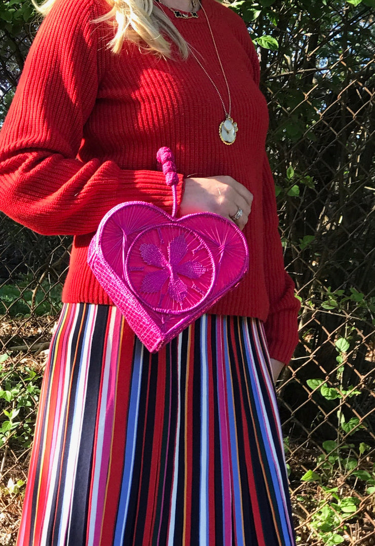 Into the Woods founder catherine woods with Hot Pink Love Heart Handwoven, Handmade Palm Handbag