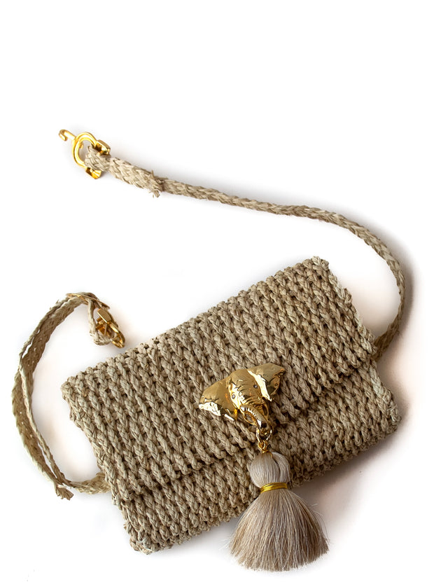"Handmade Palm Kimbo Belly Bag with Beige Tassel Brass Elephant charm, crystal eyes and 30"" waist strap, top view"