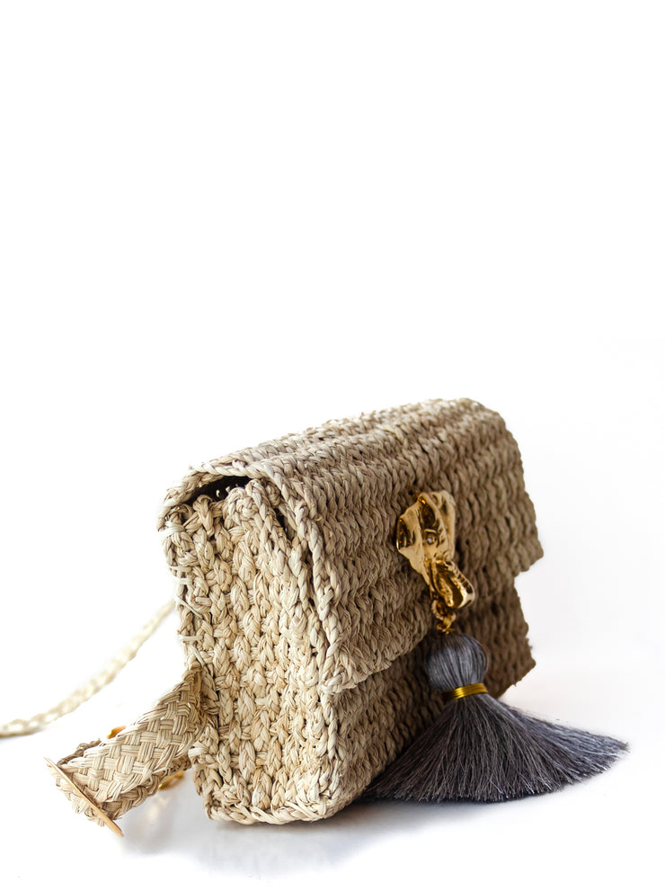 "Handmade Palm Kimbo Belly Bag with Brass Elephant charm with Gray tassel, crystal eyes and 30"" waist strap side view"