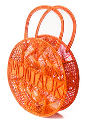 "Orange Crush 100 % Handwoven Black, Iraca Palm Bag with ""Montauk"" Woven Across Front Side view"