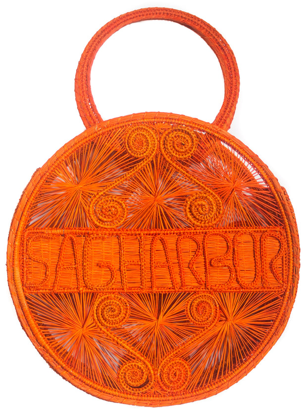"Orange Crush 100% handwoven, irate palm bag with ""Sagharbor"" woven across front."