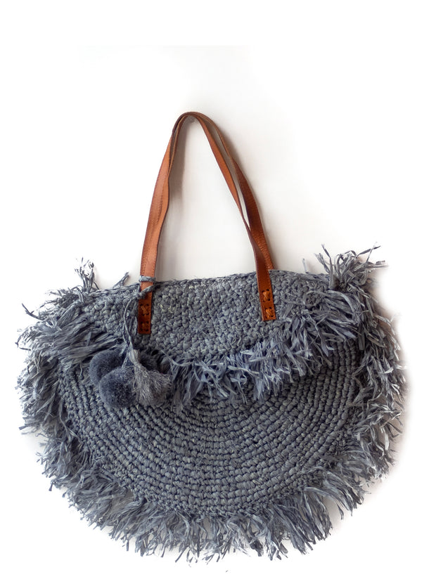 Storm Gray Raffia Shoulder Bag with Fringe and Snap Enclosure Mechanism and Pompoms, fully lined.