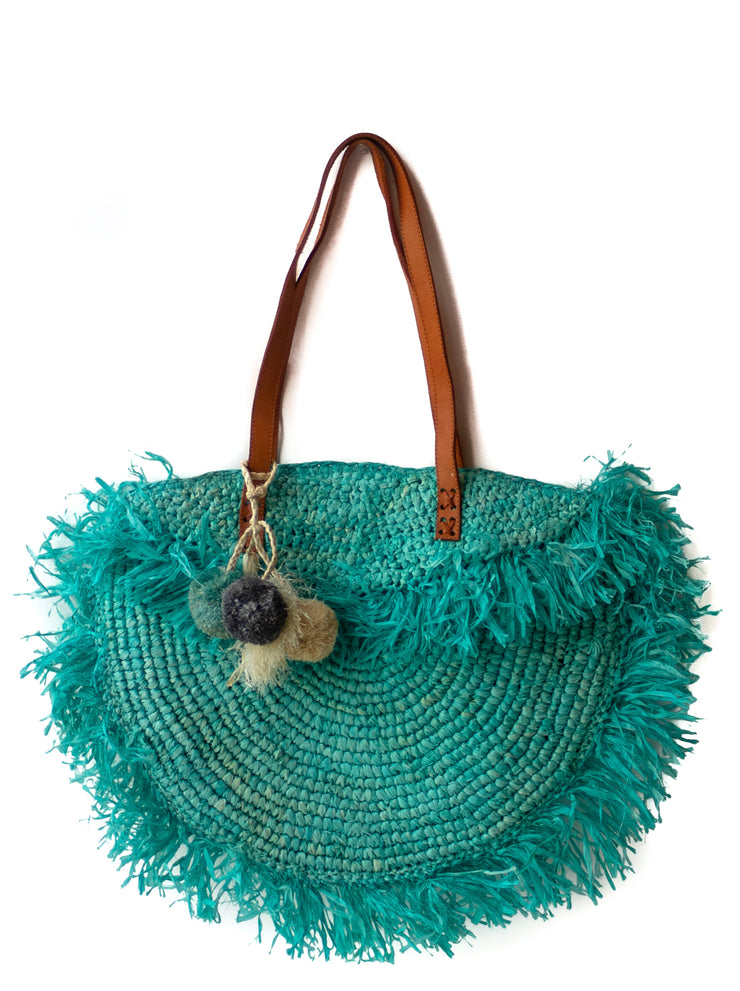 Azure Raffia Shoulder Bag with Fringe and Snap Enclosure Mechanism and Pompoms, fully lined.