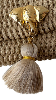 Beige Tassel and Elephant Charm with Crystals on Kimbo Belly Bag, Closeup.