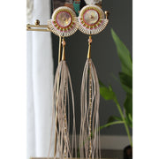 Large Grey Fly Away Feather Earrings by Catherine Blackburn | Field Museum Store