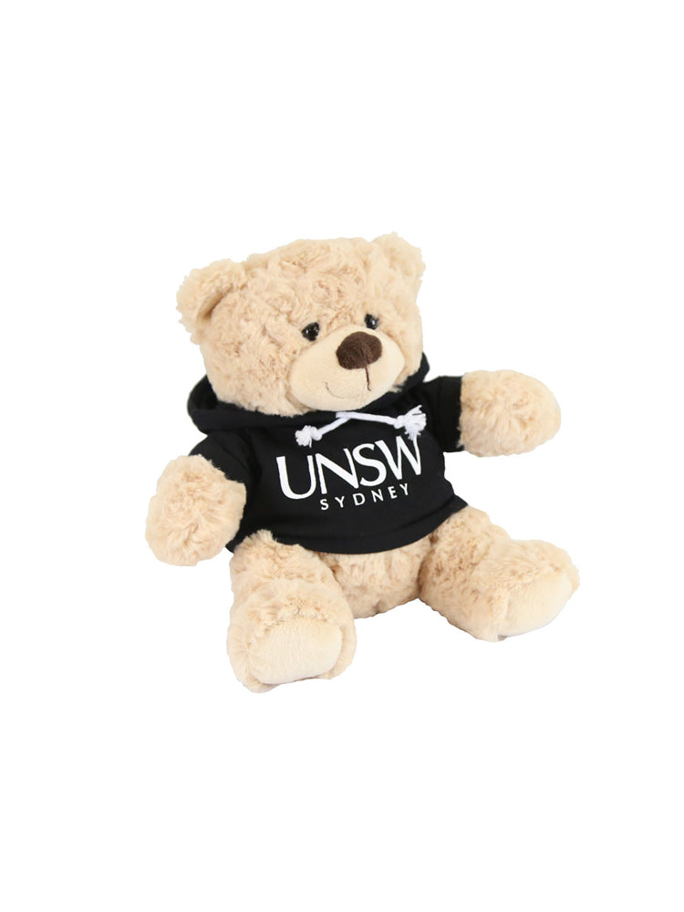 A plush bear wearing a hoodie with a UNSW logo - black
