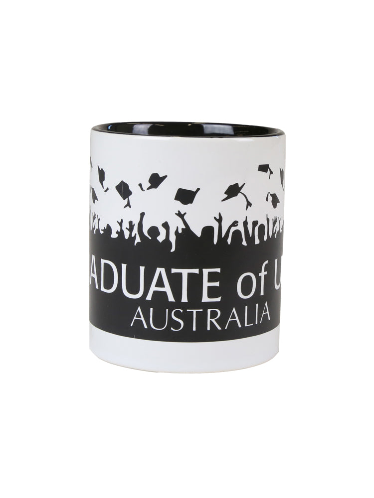 A white mug with black graduation caps and graduate of UNSW text - view 2