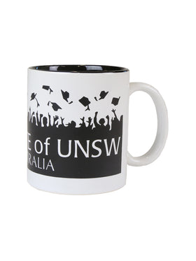 A white mug with black graduation caps and graduate of UNSW text - view 3