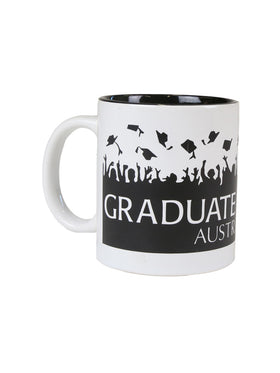 A white mug with black graduation caps and graduate of UNSW text