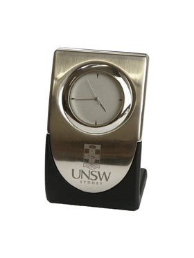 Curved silver clock with the UNSW logo