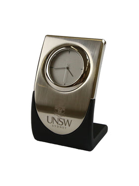 Curved silver clock with the UNSW logo - side view