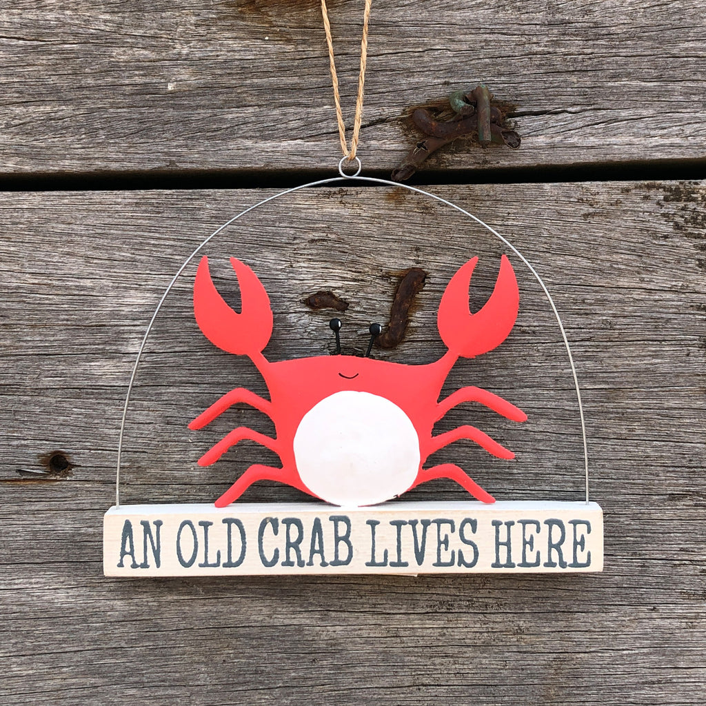 An Old Crab Lives Here Sign