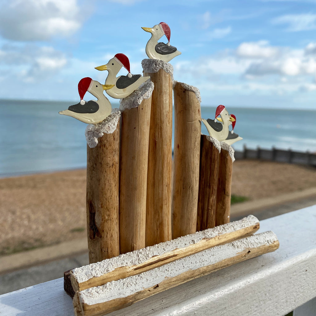Seagulls In Hats On Groynes Decoration