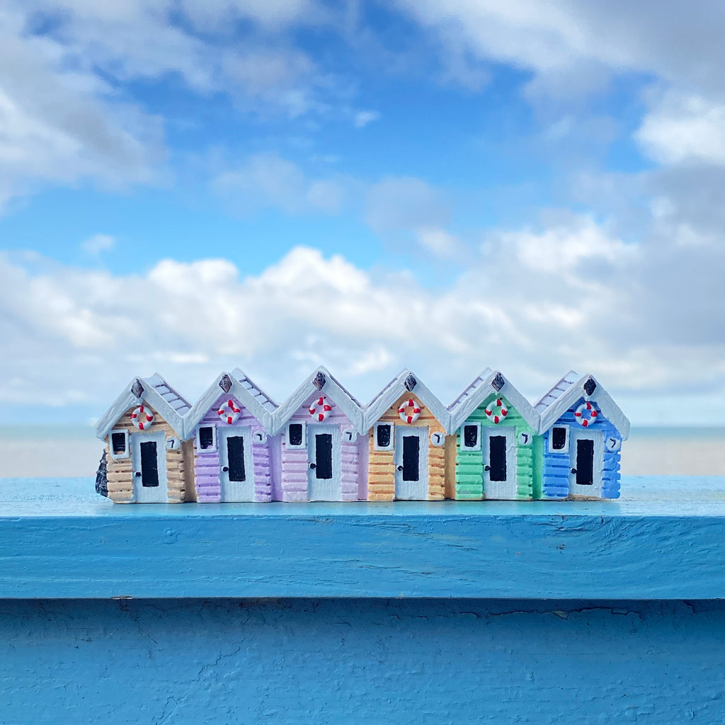 Pastel Rainbow Beach Hut Row