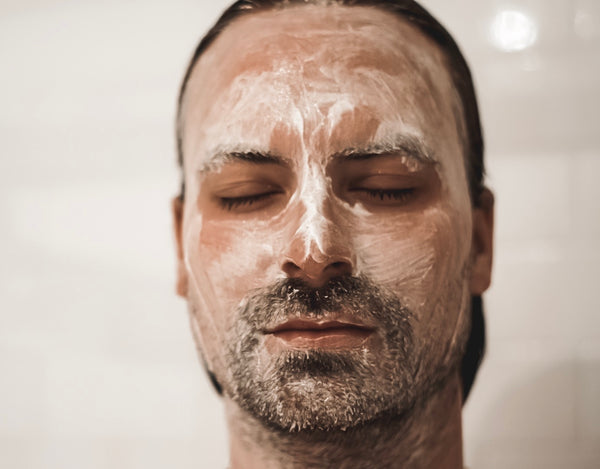 Man exfoliating face