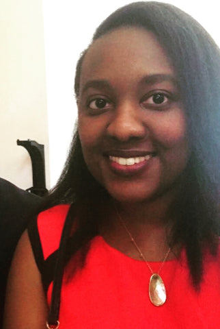 A photo of the author, Brittany, who wrote this JUNE blog post entitled The Cost of Menstrual Products.