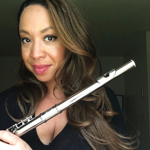 Angela Anderton, the author of the blog a New Age of Menstruation, poses with an instrument.