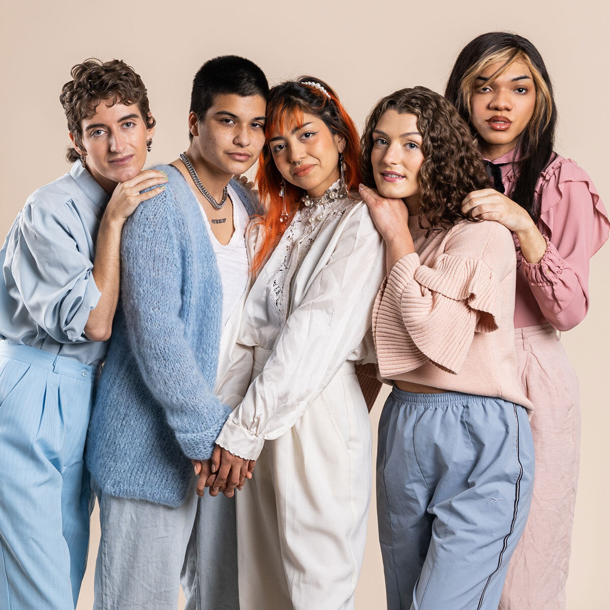 group of lgbt people leaning on eachother in pastel colors