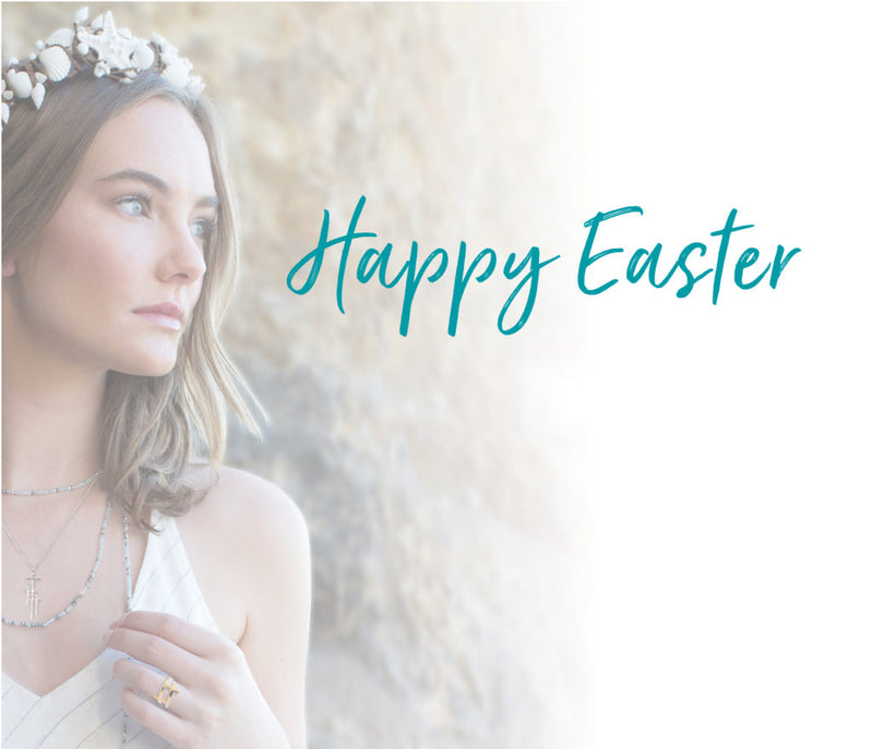 Happy Easter script over photo of young woman wearing white flowers in her hair and white dress, My Saint My Hero necklaces
