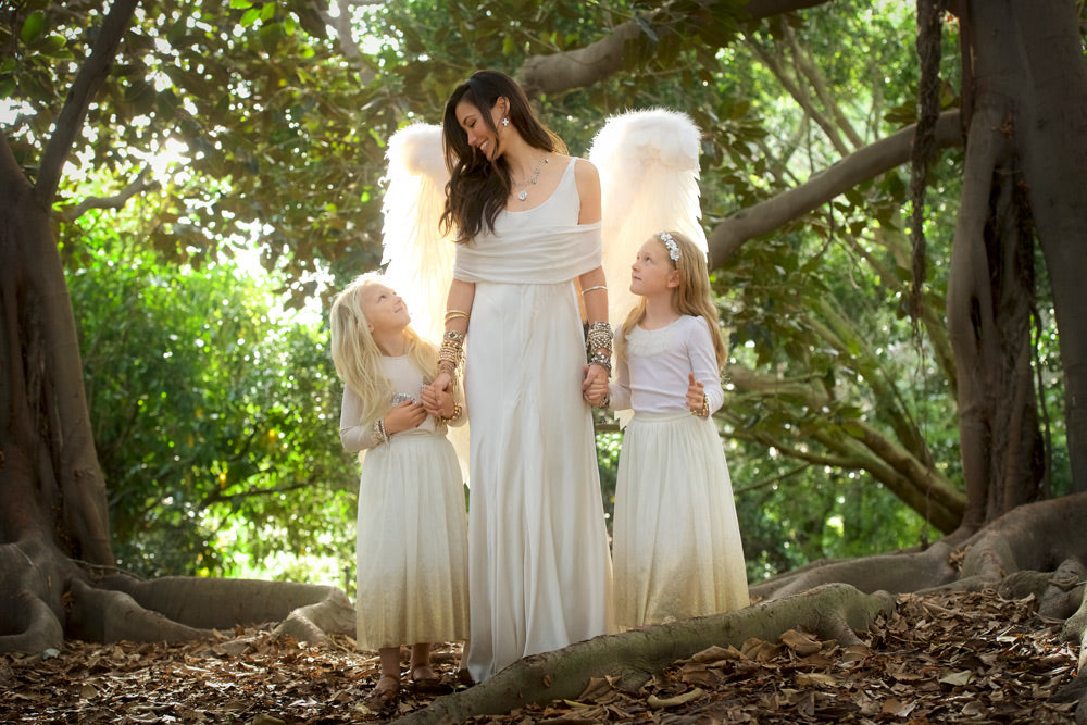 Queen of Heaven Collection - Available January 15 2018 - Caitlin in angel garb with two little girls, standing among the trees