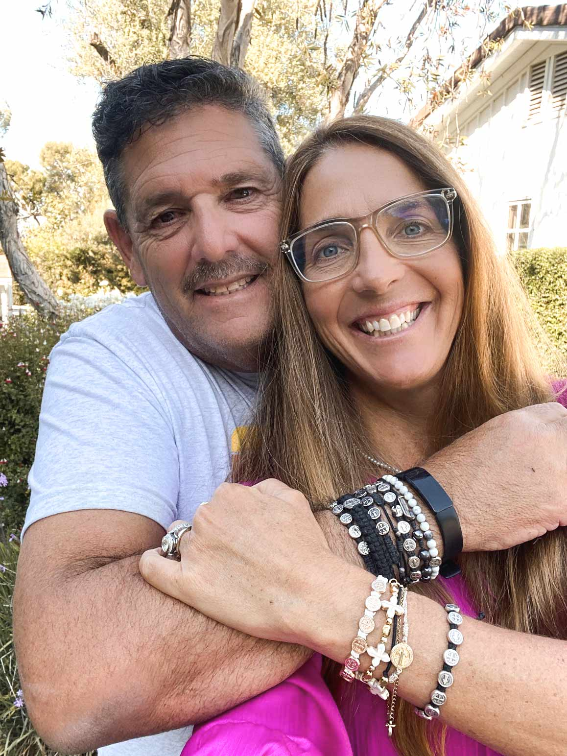 My Saint My Hero Founder Amy D'Ambra and Her Husband in Blessing Bracelets