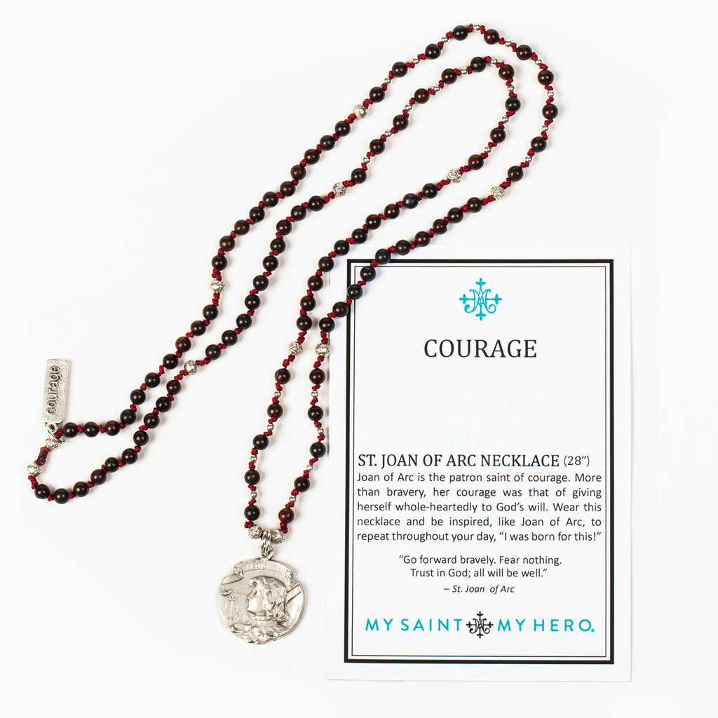 Joan of Arc Courage necklace displayed next to Courage gard