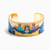 "Mary Star of the Sea Cuff -Mary Star of the Sea Cuff features an image designed for My Saint My Hero by Icon Artist Vivian Imbruglia. Epoxy printed gold plated cuff. 1"" height, 2.4"" x 1.75"" interior dimension."