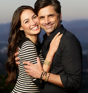 Caitlin and John Stamos in the new My Saint My Hero St. Amos Share the Love Bracelet Sets