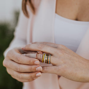 God is Greater Ring with Blessing Rings Stack on woman's hand