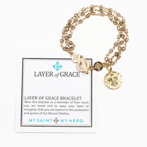 Layer of Grace crystal beaded bracelet with fleur de lis charm and inspirational card