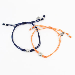 PRAYER PARTNER BRACELETS We are together in prayer for a future that is cancer-free. No one fights alone! Wear this bracelet and be part of the AUTLIVE team!  Thank you for your purchase. A percentage of the proceeds will go to AUTLIVE to raise awareness of cancer prevention and early detection. Orange and Navy woven bracelets with silver tone crosses.