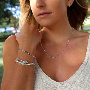 Woman wearing Benedictine Birthday Blessing Bracelets