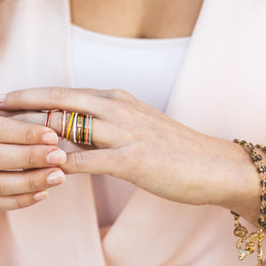 Woman wearing Blessing Bands and a God is Greater Ring