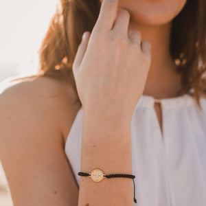 young woman in white shirt wearing Empower Seed of Life Illuminate Bracelet - Gold