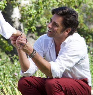 John Stamos in Share the Love StAmos Bracelets sharing a bracelet with a girl