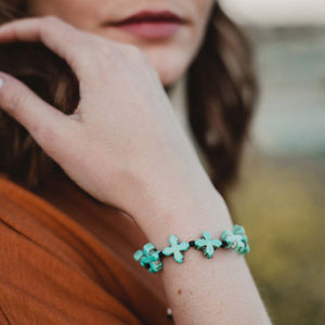 Grounded in Faith Bracelet - Blue Organic Crosses on a woman's wrist