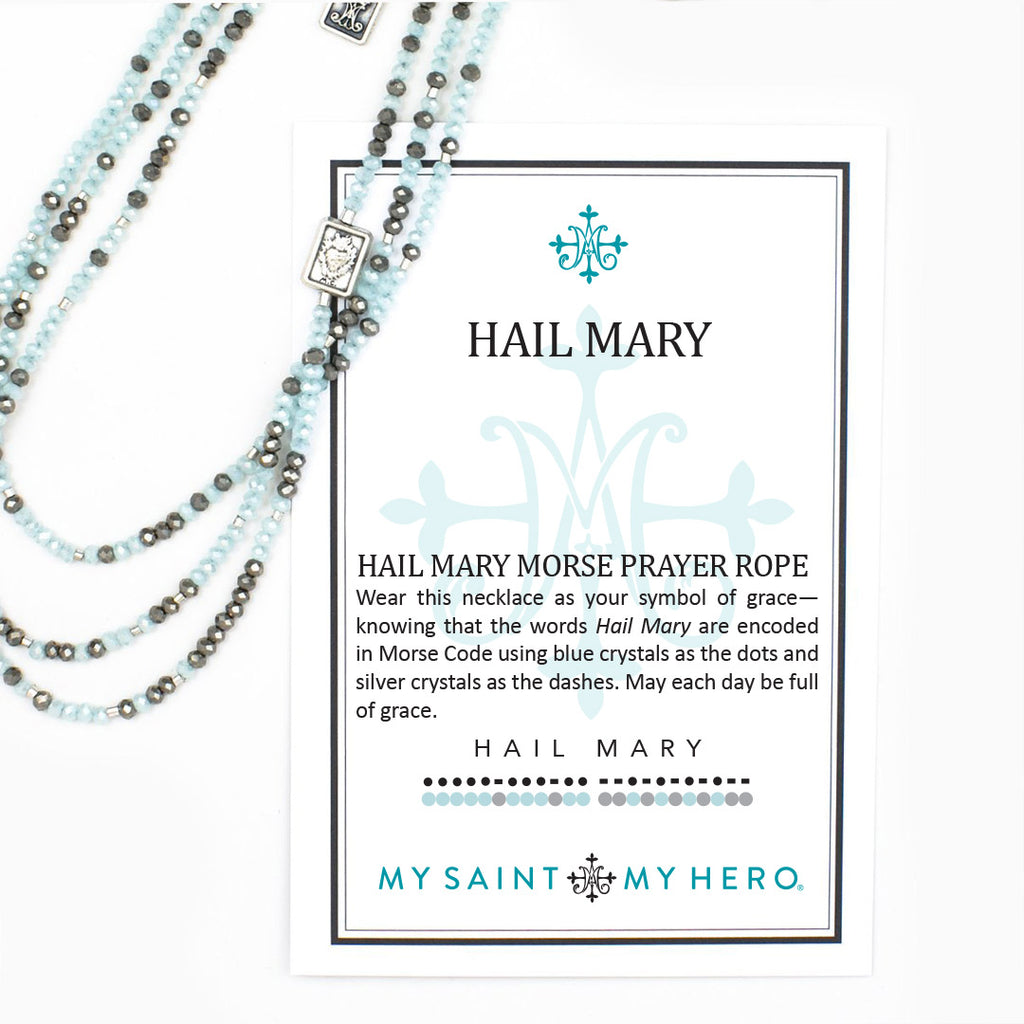"Hail Mary Morse Code Prayer Rope Necklace Aqua and silver 3mm crystals, silver dipped bugle beads, two scapular medals, 40"" prayer rope necklace with a 2"" extender This Morse Code prayer rope can be worn as a single or double strand necklace or as a wrap bracelet (model is wearing two prayer ropes) The best-selling Hail Mary Morse Code Prayer Rope comes in a box with an inspirational card"