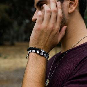 Young Man wearing Perfectly Imperfect Hematite and Lava Bead Handwoven Bracelet with Silver Tone Cross Medal