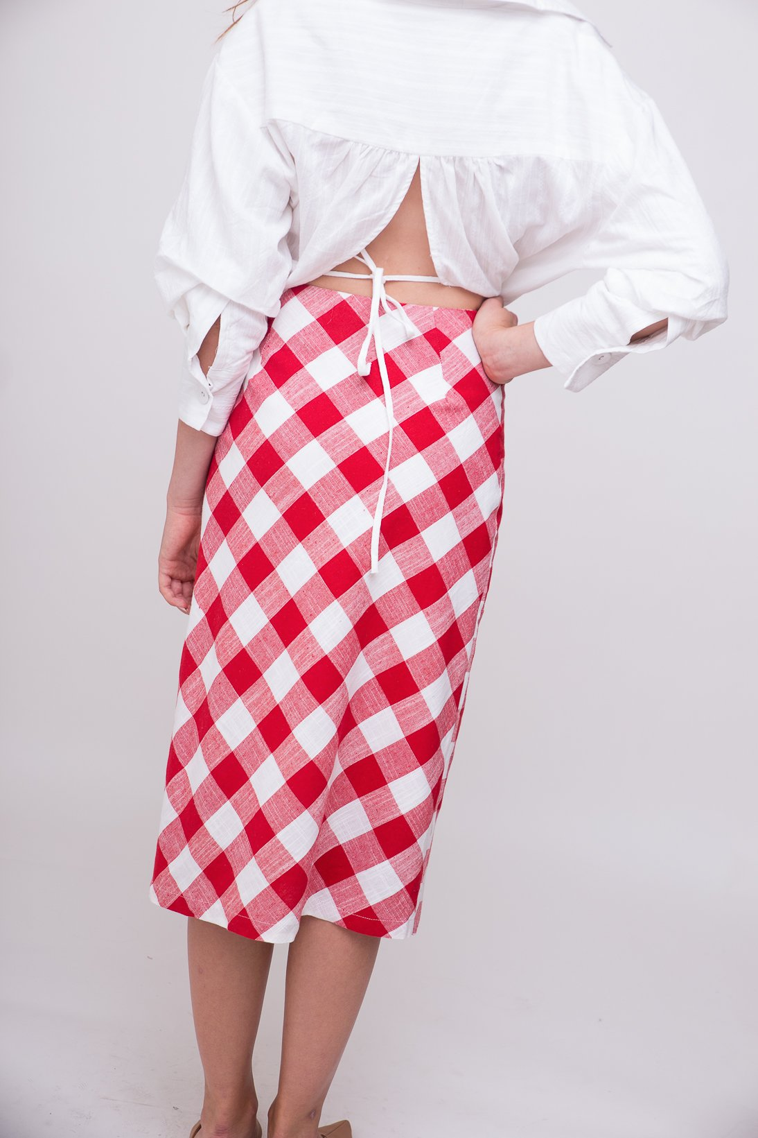 Red and white checkered, playful, midi skirt.