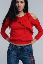Red sweater with ruffle detail at front