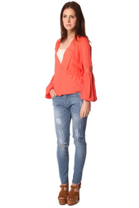Orange blouse with wrap front and draped detail
